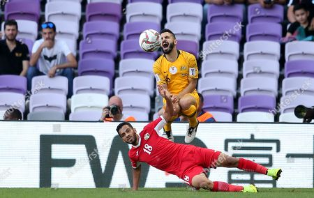 Matthew Jurman (UP) of Australia in action against Mousa Suleiman of Jordan in action during the 2019 AFC Asian Cup group B preliminary round match between Australia and Jordan in Al Ain, United Arab Emirates, 06 January 2019.