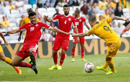 Jamie Maclaren (R) of Australia in action during the 2019 AFC Asian Cup group B preliminary round match between Australia and Jordan in Al Ain, United Arab Emirates, 06 January 2019.