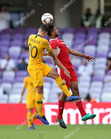 Saeed Al Murjan (R) of Jordan in action against Trent Sainsbury of Australia during the 2019 AFC Asian Cup group B preliminary round match between Australia and Jordan in Al Ain, United Arab Emirates, 06 January 2019.