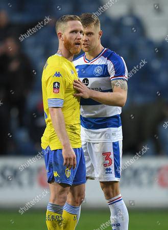 Jake Bidwell of Queens Park Rangers talks to Adam Forshaw of Leeds United at full-time