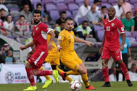 Jordan's midfielder Bahaha Abdel-Rahman, left, and Australia's forward Jamie Maclaren compete for the ball during the AFC Asian Cup group B soccer match between Australia and Jordan at the Hazza Bin Zayed stadium in Al Ain, United Arab Emirates