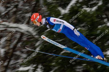 David Siegel of Germany soars through the air during a trial jump for the fourth stage of the 67th Four Hills Tournament in Bischofshofen, Austria, 6 January 2019.