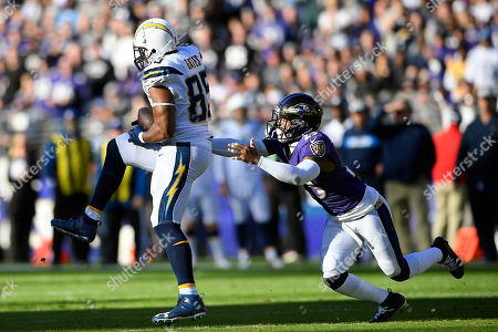 Week 13. Los Angeles Chargers tight end Antonio Gates, left, catches a pass in front of Baltimore Ravens strong safety Tony Jefferson in the first half of an NFL wild card playoff football game, in Baltimore