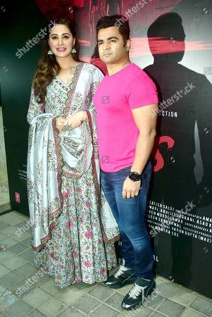 Stock Picture of Nargis Fakhri with Sachiin Joshi