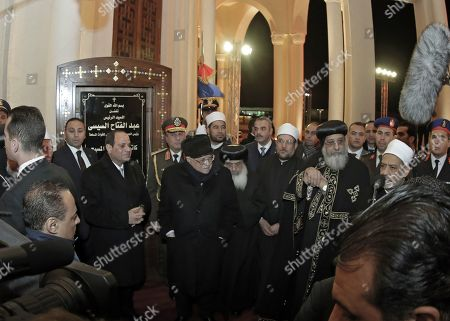 Pope Tawadros II of Alexandria receives Egyptian President Abdel Fattah al-Sisi (L), Palestinian President Mahmoud Abbas (C) Grand Imam of Al-Azhar Sheikh Ahmed el-Tayeb  (R) prior a Christmas Eve mass at the newly inaugurated Cathedral of Nativity in the New Administrative Capital, Egypt, 06 January 2019. The Middle East's biggest cathedral is inaugurated by Eygpt's President a day after a deadly bomb blast near a church. Orthodox believers celebrate Christmas Day on 07 January, according to the Julian calendar.