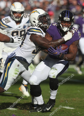 Baltimore Ravens RB Gus Edwards (35) is tackled by Los Angeles Chargers DE Melvin Ingram III (54) during the AFC wildcard playoff game at M&T Bank Stadium in Baltimore, MD on Photo/ Mike Buscher / Cal Sport Media