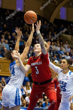 Louisville's Sam Fuehring (3) attempts a shot between Duke's Faith Suggs (14) and Jade Williams (25) during the first half of an NCAA college basketball game in Durham, N.C
