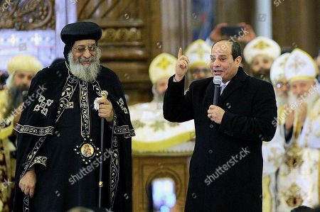 """Egyptian President Abdel-Fattah el-Sissi, right, speaks to Coptic Christians as he is accompanied by Coptic Pope Tawadros II, during Christmas Eve Mass at the new """"Cathedral of the Nativity of Christ,"""" in the new administrative capital, 40 kilometers (25 miles) east of Cairo, Egypt, late . Egypt's president is inaugurating a new cathedral for the Coptic Orthodox Church and one of the region's largest mosques in a highly symbolic gesture at a time when Islamic militants are seen to be targeting the country's minority Christians"""
