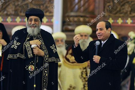 """Egyptian President Abdel-Fattah el-Sissi, right, speaks to Coptic Christians as he is accompanied by Coptic Pope Tawadros II, during Christmas Eve Mass at the new """"Cathedral of the Nativity of Christ,"""" in the new administrative capital, 40 kilometers (25 miles) east of Cairo, Egypt, late . Egypt's president is inaugurating a new cathedral for the Coptic Orthodox Church and one of the region's largest mosques in a highly symbolic gesture at a time when Islamic militants are increasingly targeting the country's minority Christians"""