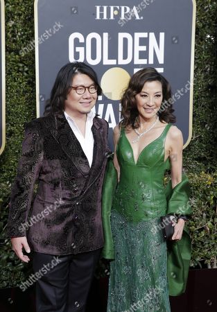 Michelle Yeoh (R) and Kevin Kwan arrives for the 76th annual Golden Globe Awards ceremony at the Beverly Hilton Hotel, in Beverly Hills, California, USA, 06 January 2019.