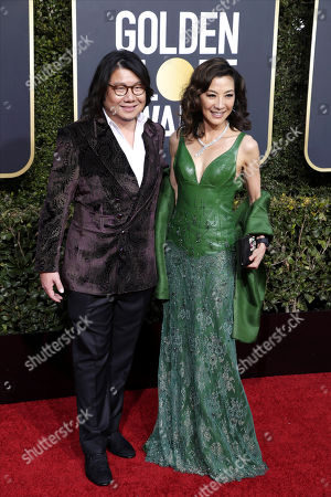 Kevin Kwan (L) and Michelle Yeoh arrive for the 76th annual Golden Globe Awards ceremony at the Beverly Hilton Hotel, in Beverly Hills, California, USA, 06 January 2019. *** Local Caption *** 52514391