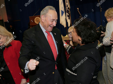 Stock Picture of United States Senator Chuck Schumer greets former Attorney General Loretta Lynch during an inauguration ceremony for the new Attorney General of New York, Letitia James, in New York