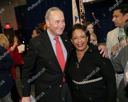 Stock Image of United States Senator Chuck Schumer greets former Attorney General Loretta Lynch during an inauguration ceremony for the new Attorney General of New York, Letitia James, in New York