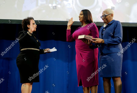 The new Attorney General of New York, Letitia James, second from right, takes the oath of office with the help of former United States Attorney General Loretta Lynch during an inauguration ceremony in New York