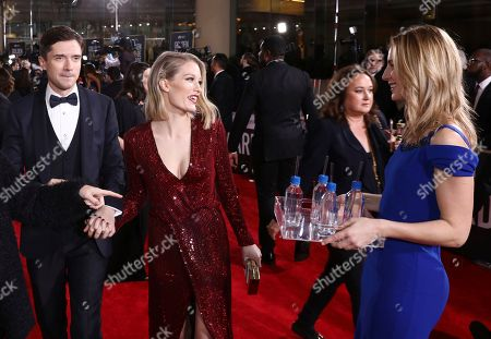 Topher Grace, Ashley Hinshaw. Topher Grace, left, and Ashley Hinshaw at the 76th annual Golden Globe® Awards with FIJI Water