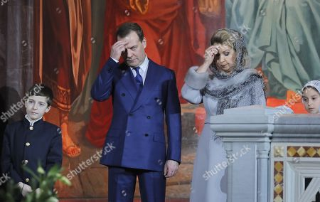 Russian Prime Minister Dmitry Medvedev (CL) and his wife Svetlana Medvedeva (CR) make the sign of the cross during a midnight Christmas service at Christ the Savior cathedral in Moscow, Russia, late 06 January 2019. The Russian Orthodox church celebrates Christmas on 07 January according to the Julian calendar.