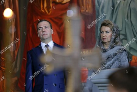 Russian Prime Minister Dmitry Medvedev (L) and his wife Svetlana Medvedeva (R) attend a midnight Christmas service at Christ the Savior cathedral in Moscow, Russia, 06 January 2019. The Russian Orthodox church celebrates Christmas on 07 January according to the Julian calendar.