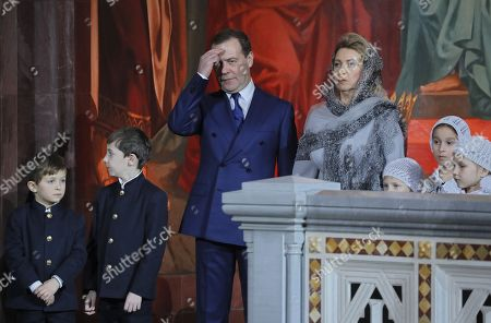 Russian Prime Minister Dmitry Medvedev (CL) and his wife Svetlana Medvedeva (CR) attend a midnight Christmas service at Christ the Savior cathedral in Moscow, Russia, 06 January 2019. The Russian Orthodox church celebrates Christmas on 07 January according to the Julian calendar.