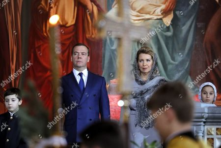 Russian Prime Minister Dmitry Medvedev (L) and his wife Svetlana Medvedeva (R) attend a midnight Christmas service at Christ the Savior cathedral in Moscow, Russia, late 06 January 2019. The Russian Orthodox church celebrates Christmas on 07 January according to the Julian calendar.