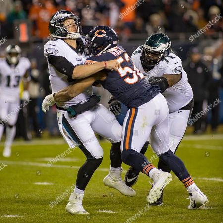 Chicago, Illinois, U.S. - Bears #52 Khalil Mack puts pressure on Eagles Quarterback #9 Nick Foles during the NFL Playoff Game between the Philadelphia Eagles and Chicago Bears at Soldier Field in Chicago, IL. Photographer: Mike Wulf