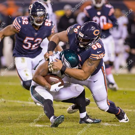 Chicago, Illinois, U.S. - Bears #96 Akiem Hicks tackles #43 Darren Sproles during the NFL Playoff Game between the Philadelphia Eagles and Chicago Bears at Soldier Field in Chicago, IL. Photographer: Mike Wulf