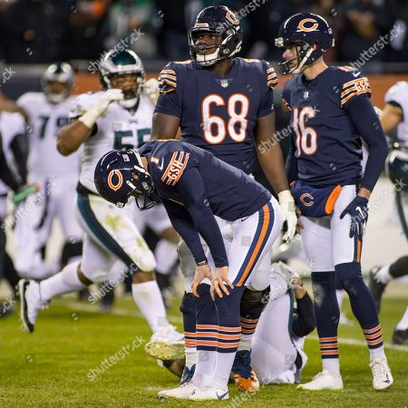 Chicago, Illinois, U.S. - Bears Kicker #1 Cody Parkey, #68 James Daniels and #16 Pat O'Donnell react after missing the game winning field goal during the NFL Playoff Game between the Philadelphia Eagles and Chicago Bears at Soldier Field in Chicago, IL. Photographer: Mike Wulf