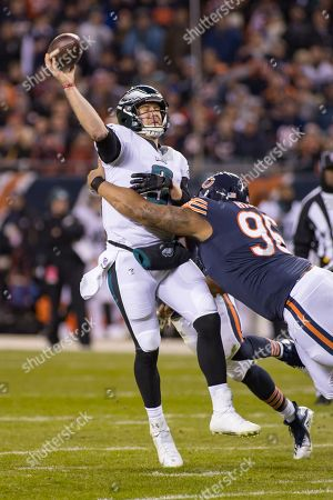 Chicago, Illinois, U.S. - Bears #96 Akiem Hicks puts pressure on Eagles Quarterback #9 Nick Foles during the NFL Playoff Game between the Philadelphia Eagles and Chicago Bears at Soldier Field in Chicago, IL. Photographer: Mike Wulf