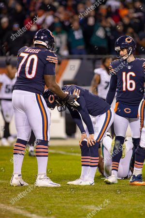 Stock Picture of Chicago, Illinois, U.S. - Bears Kicker #1 Cody Parkey is consoled by #70 Bobby Massie after missing the game winning field goal during the NFL Playoff Game between the Philadelphia Eagles and Chicago Bears at Soldier Field in Chicago, IL. Photographer: Mike Wulf