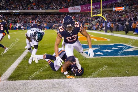 Chicago, Illinois, U.S. - Bears #23 Kyle Fuller leaps over #38 Adrian Amos as he catches an interception in the end zone intended for Eagles #13 Nelson Agholor during the NFL Playoff Game between the Philadelphia Eagles and Chicago Bears at Soldier Field in Chicago, IL. Photographer: Mike Wulf
