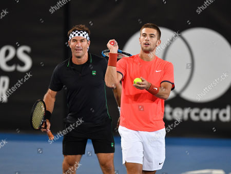 Pat Cash (L) and Borna Coric during their doubles game against Henri Leconte and Eugenie Bouchard at the World Tennis Challenge at Memorial Drive Park in Adelaide, Monday, January 7, 2019.