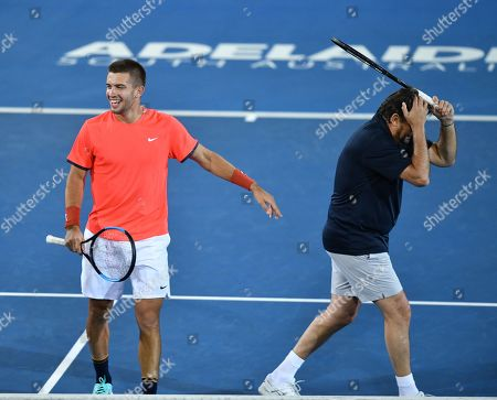 Borna Coric (L) and Henri Leconte during their  doubles game at the World Tennis Challenge at Memorial Drive Park in Adelaide, Australia, 07 January 2019.