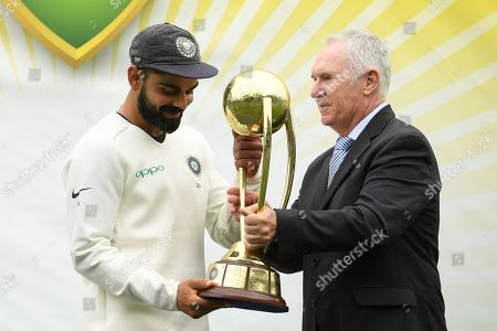Indian captain Virat Kohli (L) accepts the Border-Gavaskar Trophy from former Australian cricketer Allan Border (R) following their 2-1 series victory over Australia following play being abandoned in the Fourth Test match between Australia and India at the SCG in Sydney, Australia, 07 January 2019.