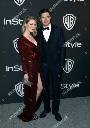 Ashley Hinshaw, Topher Grace. Ashley Hinshaw, left, and Topher Grace arrive at the InStyle and Warner Bros. Golden Globes afterparty at the Beverly Hilton Hotel, in Beverly Hills, Calif