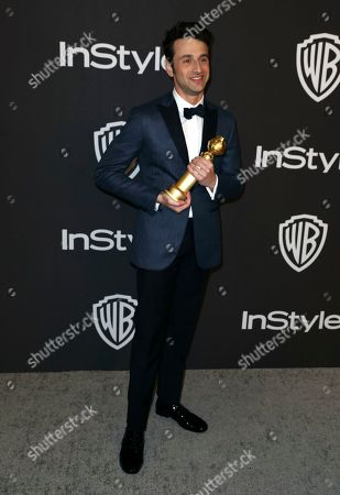 """Justin Hurwitz, winner of the award for best original score, motion picture for """"First Man,"""" arrives at the InStyle and Warner Bros. Golden Globes afterparty at the Beverly Hilton Hotel, in Beverly Hills, Calif"""