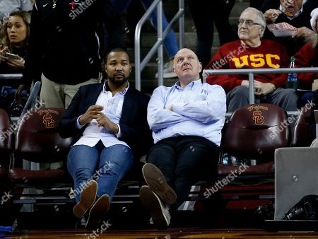 Stock Picture of Former Microsoft CEO Steve Ballmer, right, watches during an NCAA college basketball game between Southern California andStanford, in Los Angeles. The Southern California won 77-66