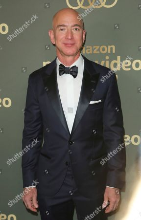 Jeff Bezos arrives at the Amazon Golden Globes afterparty at the Beverly Hilton Hotel, in Beverly Hills, Calif