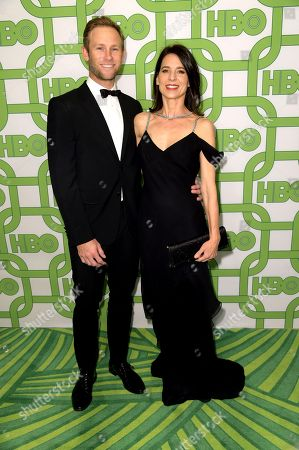 Stock Picture of Aaron Fox, Perrey Reeves. Aaron Fox, left, and Perrey Reeves arrive at the HBO Golden Globes afterparty at the Beverly Hilton Hotel, in Beverly Hills, Calif