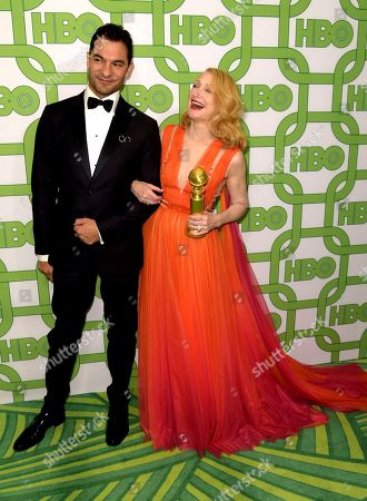 """Darwin Shaw, Patricia Clarkson. Darwin Shaw, left, and Patricia Clarkson, winner of the award for best performance by an actress in a supporting role in a series, limited series or motion picture made for television for """"Sharp Objects"""", arrive at the HBO Golden Globes afterparty at the Beverly Hilton Hotel, in Beverly Hills, Calif"""