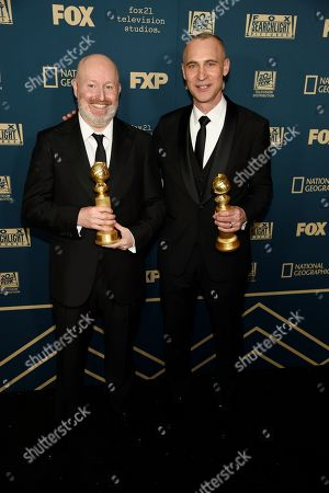 """Joe Weisberg, Joel Fields. Joe Weisberg, left, and Joel Fields pose with the award for best television series, drama for """"The Americans"""" at the Fox afterparty at the Beverly Hilton Hotel, in Beverly Hills, Calif"""