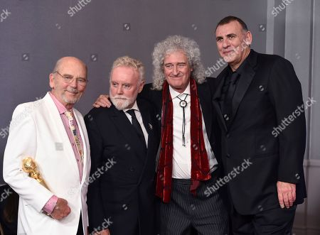 "Jim Beach, Roger Taylor, Brian May, Graham King. Jim Beach, from left, Roger Taylor, Brian May and Graham King pose in the press room with the award for best motion picture, drama for ""Bohemian Rhapsody"" at the 76th annual Golden Globe Awards at the Beverly Hilton Hotel, in Beverly Hills, Calif"