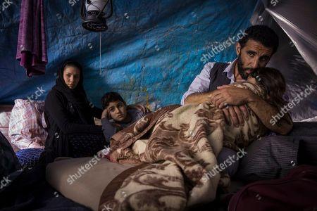 Stock Photo of Nicole Chamoun as Zahra Al-Bayati, Maha Riad as Yasmeen Al-Bayati and Hazem Shammas as Ismail Al-Bayati