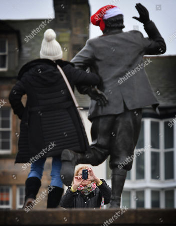 A Woman Has Her Photograph Taken Next To The Statue Of Comedian Eric Morecambe On Morecambe Seafront. - Labour Group Momentum's Tactics In Lancashire Town Of Morecambe./copy Reid -20/12/17 Sue Reid Investigation -.