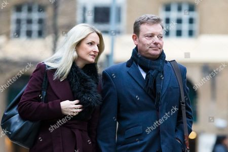 Craig Mackinlay with his wife Kati arrives at Southwark Crown Court