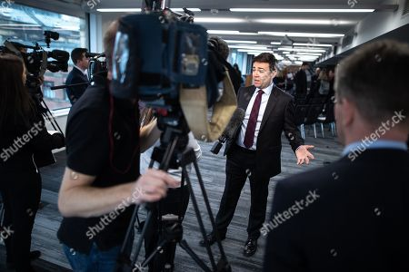The Metro Mayor of Greater Manchester Andy Burnham speaks to media after announcing a revised plan for new housing (some on greenbelt land), transport infrastructure, the reduction of pollution and improvements to the environment across the North West, alongside the regeneration of Stockport Town Centre, at an event at etc Venues in Manchester City Centre.