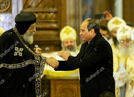 """Abdel-Fattah el-Sissi, Tawadros II. Egyptian President Abdel-Fattah el-Sissi, right, greets Coptic Pope Tawadros II, before the Christmas Eve Mass, at the new """"Cathedral of the Nativity of Christ,"""" in the new administrative capital, 40 kilometers (25 miles) east of Cairo, Egypt in Egypt's new Administrative Capital. El-Sissi on Sunday inaugurated the new cathedral for the Coptic Orthodox Church and one of the region's largest mosques in a highly symbolic gesture at a time when Islamic militants are increasingly targeting the country's minority Christians"""