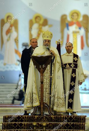 """Coptic Pope Tawadros II, leads the Christmas Eve Mass at the """"Cathedral of the Nativity of Christ,"""" in the new administrative capital, 40 kilometers (25 miles) east of Cairo, Egypt. On Sunday Egyptian President Abdel-Fattah el-Sissi, inaugurated the new cathedral for the Coptic Orthodox Church and one of the region's largest mosques. Sunday's opening ceremony is a highly symbolic gesture at a time when Islamic militants are increasingly targeting the country's minority Christians"""