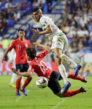 Philippines' defender Alvaro Silva, right, challenges South Korea's midfielder Lee Jae-Sung during the AFC Asian Cup group C soccer match between South Korea and Philippines at Al Maktoum Stadium in Dubai, United Arab Emirates