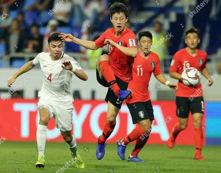 South Korea's midfielder Lee Jae-Sung kicks the ball ahead of Philippines' midfielder John-Patrick Strauss during the AFC Asian Cup group C soccer match between South Korea and Philippines at Al Maktoum Stadium in Dubai, United Arab Emirates