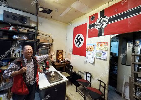 Betel nut shop owner Mr Chen talks to a reporter in his shop in Taipei, Taiwan, 07 January 2019. Chen recently has attracted media attention after an American photographer photographed the two Nazi swastica flags in Chen's shop and posted the photo on Instagram. The photographer asked Chen to remove the flags but Chen refused, saying he has displayed the flags for ten years as 'art' and no one had ever interfered. In recent years, a dozen incidents involving Nazi symbol have occurred in Taiwan, including a restaurant selling 'Long Live Nazi' spaghetti, a high school turning its Christmas celebration into a Nazi parade with students waving Nazi flags and shouting 'Heil Hitler' to the school principal, and 'Berlin Hair Salon' using the Nazi swastika to design its shop logo.