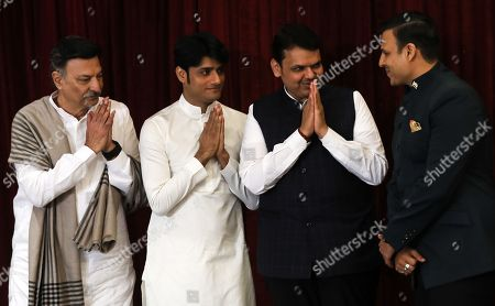Bollywood actor Suresh Oberoi (L), film producer Sandip Singh (2-L), Devendra Fadnavis (2-R), chief minister of Maharashtra, gestures as bollywood actor Vivek Oberoi (R), looks at them during the poster launch of upcoming film 'PM Narendra Modi', a biopic on Indian Prime Minister, Narendra Modi, in Mumbai, India, 07 January 2019. Vivek Oberoi plays the character of Indian Prime Minister Narendra Modi in the movie.